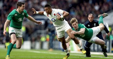 RBS 6 Nations Championship Round 3, Twickenham Stadium, London, England 27/2/2016 England vs Ireland Anthony Watson of England tries to get away from Andrew Trimble and Jonathan Sexton of Ireland Mandatory Credit ©INPHO/Andrew Fosker
